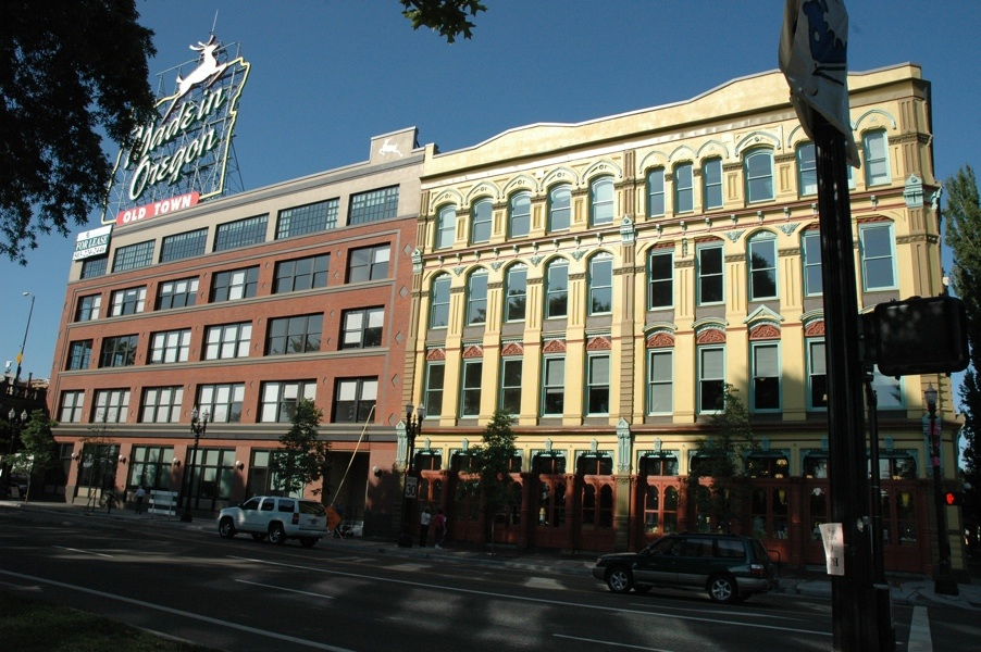exterior photo of new UO Portland building displaying the UO banner and the White Stag Made in Oregon sign.